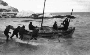 Frank Hurley's photo of teh launch of James Caird from Elephant Island.